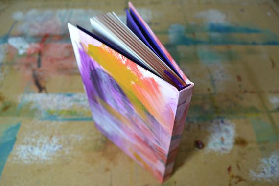 If you are looking for a journal thats a little bit different, look no further! This beautiful book holds 100 pages of thick, white, unlined 140gsm cartridge paper, suitable for all media. This book is complete with unique hand-painted cover, metallic page edges and ribbon page marker. Whether you want to jot down ideas, write a novel or sketch your surroundings, this, hand-painted, handcrafted journal is completely unique, just like you