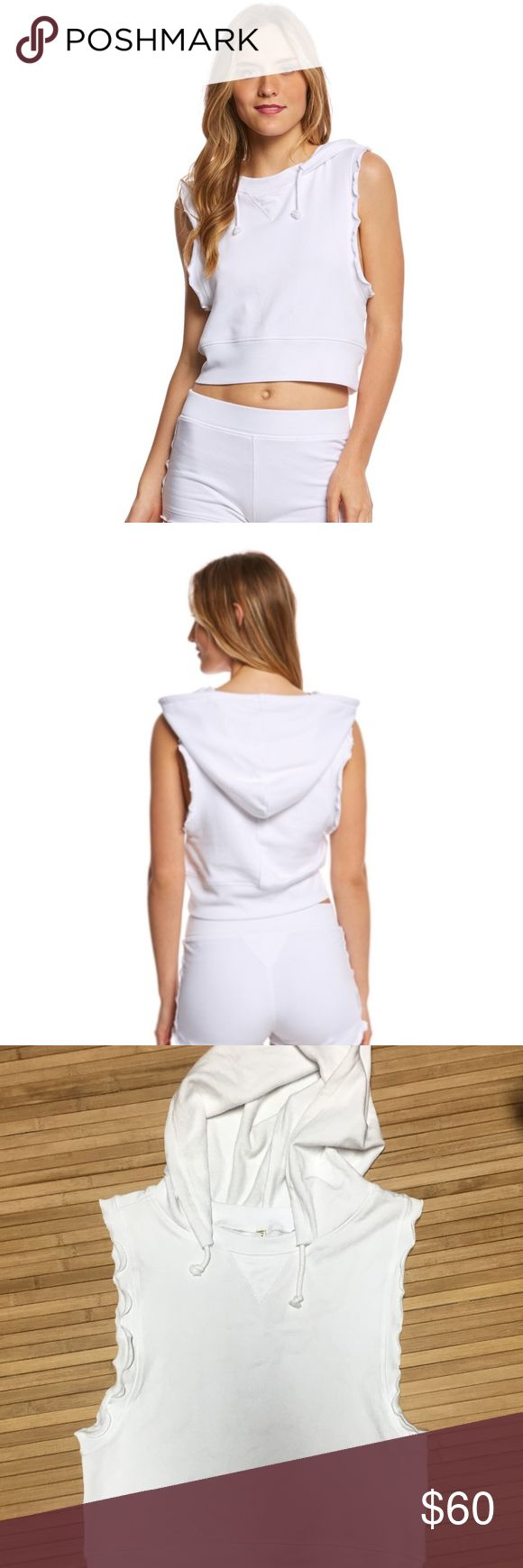 FREE PEOPLE SLEEVELESS HOODIE Relaxed fit Fabrics: 59% Cotton, 38% Rayon, 3% Spandex Color: Ivory/white Cropped sweatshirt. Classic sweatshirt triangle stitching at neckline. Attached hood with drawstrings. Sleeveless design with low-cut arm openings and raw edges. Ribbed hemline. Seam down center back with raw edge trim. Super soft and stretchy material Free People Tops Sweatshirts & Hoodies