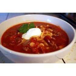 Browned ground beef seasoned with a package of taco seasoning is combined in a slow cooker with canned beans, tomatoes, and green chilies.  Serve with tortilla chips and a dollop of sour cream.