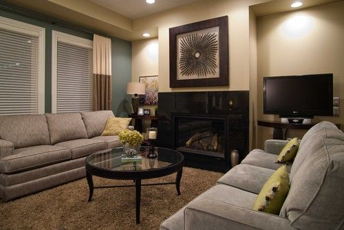 small living room with fireplace furniture placement new york city grey couch, beige wall, brown carpet | ...