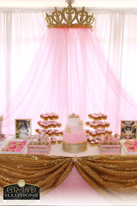 Custom Dessert Table Gold glitter crown with pink drapes adorn the back of this beautiful table.  Custom cake, cake pops, candy jars, chocolate dipped strawberries, chocolate dipped, heart shaped rice krispy treats, tutu marshmallows and the parent's maternity photos make this table extraordinarily beautiful. #decoracionbabyshowergirl