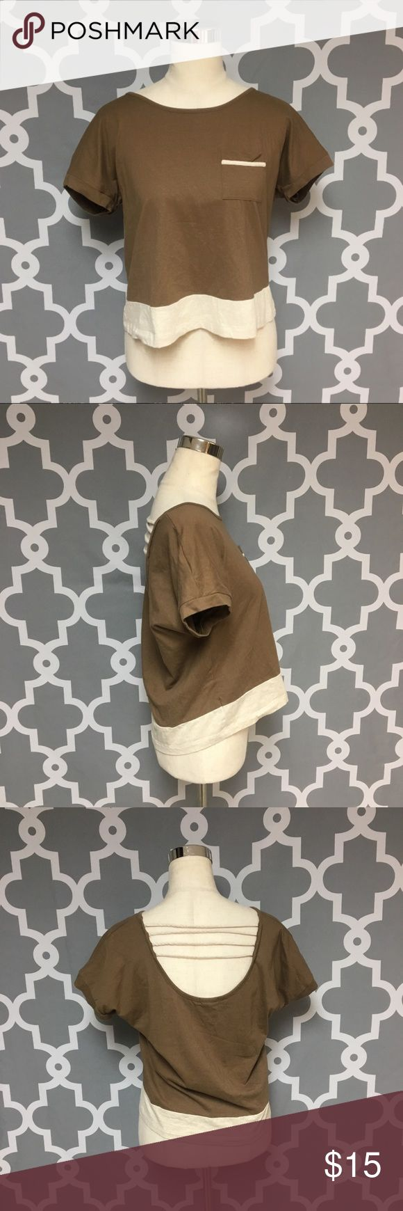 Caged Back Brown Box Fit Top : H Zenna Outfitters brown and cream Strappy Back Box Fit Top women's size large good used condition  Approximate measurements  ▪️Pit to Pit 19.5 inches  ▪️Shoulder to Hem 21 inches  Thank you for checking out my closet! Offers are always welcome or bundle for bigger savings. If you have any questions feel free to ask! Zenna Outfitters Tops