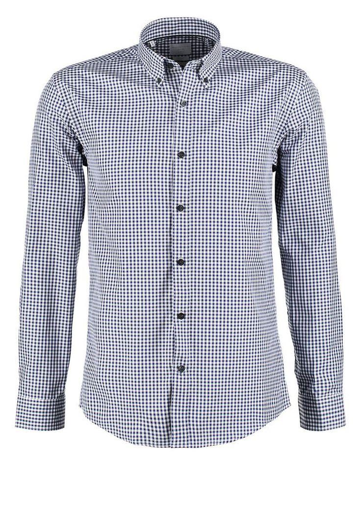- Slim fit - 100 % Baumwolle - Button-down-Kragen - Normale Knopfblende - Schlitz an den Manschetten mit Knopfverschluss - Leicht zu bügeln - Bequeme Qualität Ein Hemd, das Qualität und Raffinesse versprüht, dadurch erhältst du einen smarten aber stylischen Ausdruck. Dieses Hemd passt wunderbar unter einem Blazer oder zu einem Merino-Pullover.