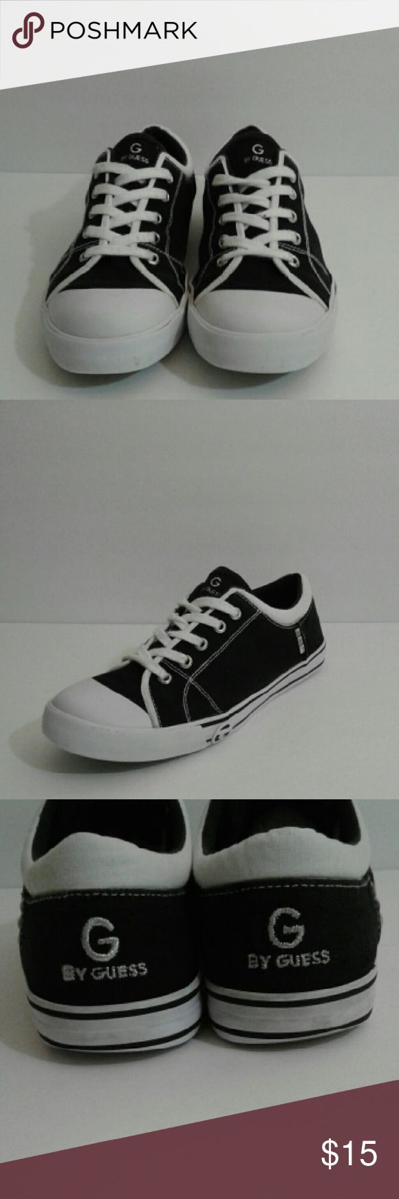 Women Guess Sneakers Guess Black and White super cute comfortable sneakers... can be worn with any casual attire in great condition.. normal wear on the insole... Otherwise great pair of shoes... Guess Shoes Sneakers