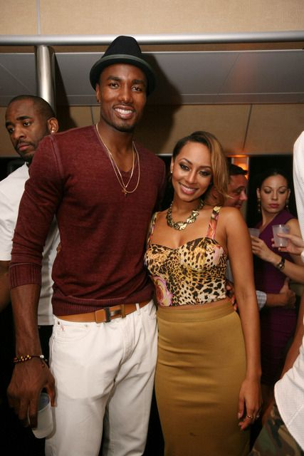 Serge Ibaka, in a burgundy v-neck sweater, white jeans and black hat, and Keri Hilson in a dark beige pencil skirt and a leopard print bustier, posed during the joint birthday party for Serge Ibaka and Angela Simmons. Don't they look cute together? What do you think?