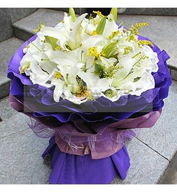 Bouquet of Pure White Lilies wrapped in Imported Paper Packing with seasonal foliage. #FlowerDeliveryMumbai #EasyFlowers