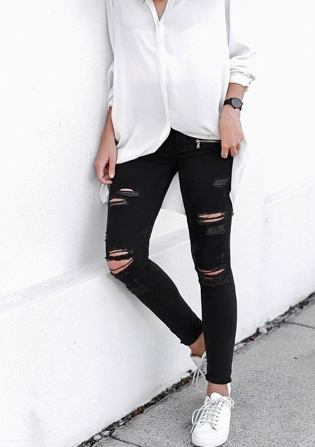 Ripped black jeans look good with just about anything, but a simple white shirt is a perfect pairing.