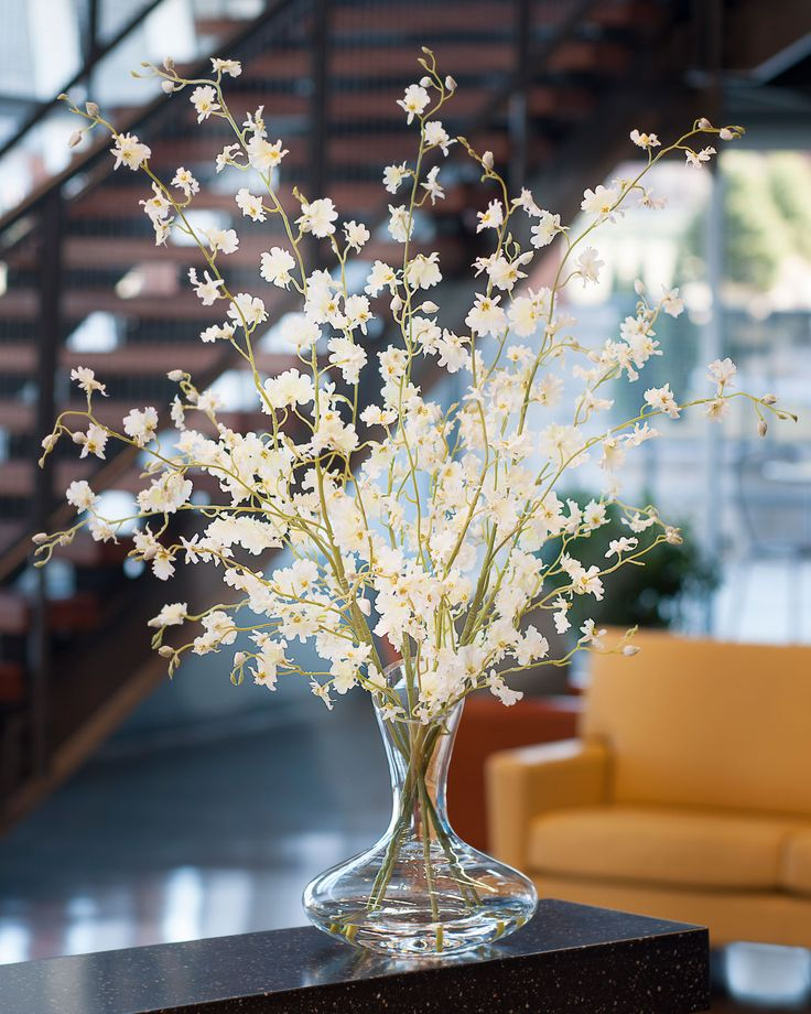 Dancing oncidium silk orchids in white add beauty to