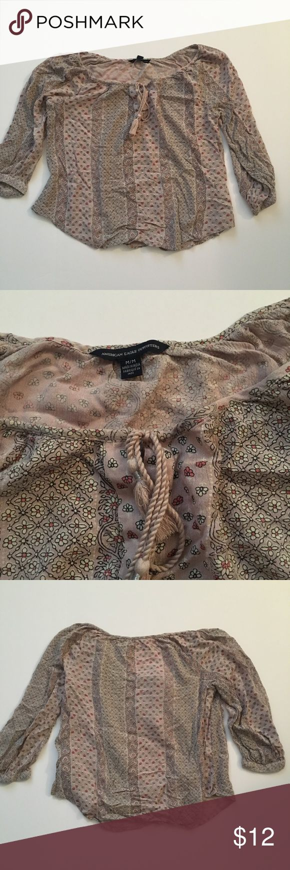 American eagle boho blouse •American Eagle Boho Blouse. Tassal tie in front  •100% viscose  •Size:Medium  •All Items checked for stains, holes, and excessive wear: If no issues noted then item is in very good condition!  •Comes from smoke free home •Have cats: all items come freshly laundered but a few hair might be on clothing. •Original retail: $40 •Open to offers •Bundle discounts available •Ships within 24 hours of purchasing, will communicate if not able to ship in that time •Feel free…