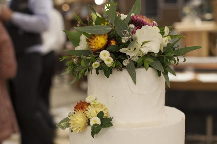 Candida Purezza - Three-tiered cake finished in buttercream and topped with blushing bride flowers