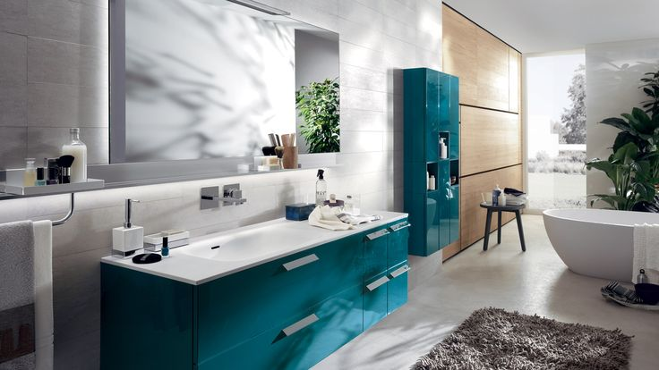 """Aquo 12345678910111213info The solutions of this composition with glossy lacquered Baltic Blue doors benefits from the ample range of accessories and space-organizers for storing away the things we use every day. Cristalplant top, with 60 cm integrated """"Feature"""" washbasin"""