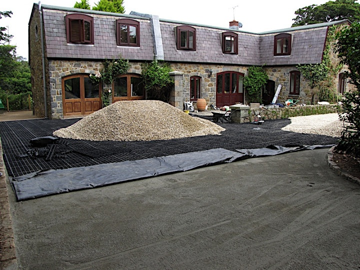 Low-cost gravel driveway grids that are weatherproof and made from recycled plastics to be environmentally friendly. http://www.gridforce.co.uk/ground-reinforcement-uses/driveways.html