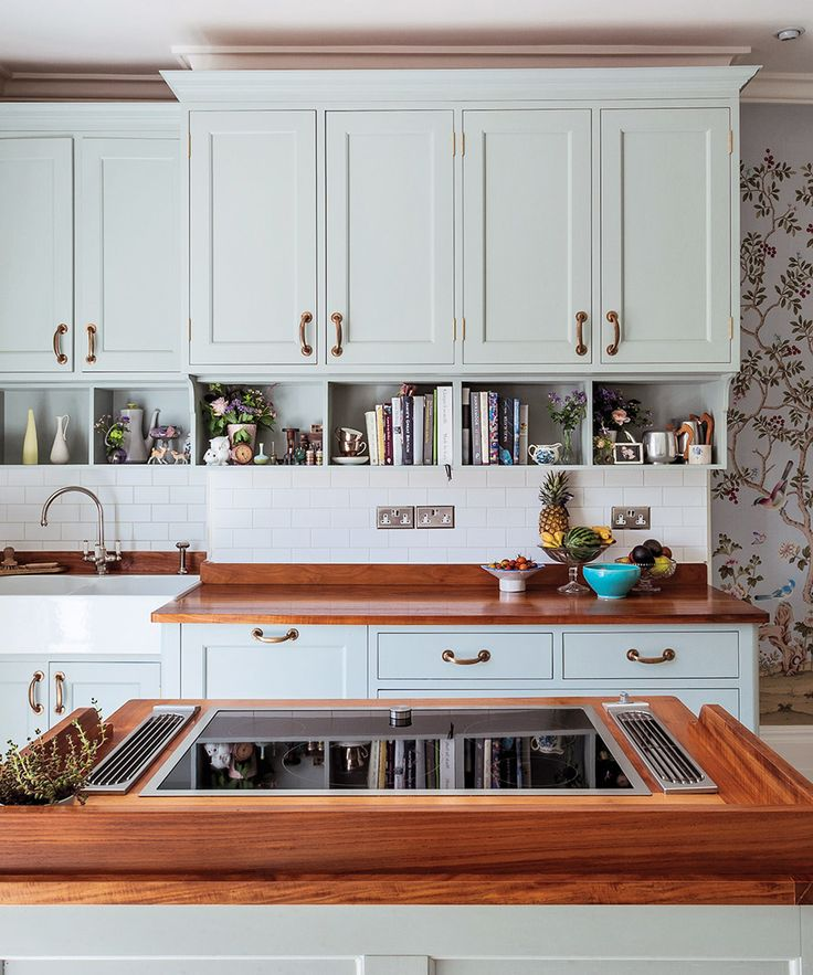 The New Romantic Kitchen - A 1949 house in Studio City, California owned by interior designer Amanda Pays. The Details: Cabinets, cooktop island and cherry counters by furniture-designing brothers Ben and Tim Goodingham, brass hardware from a Lake District hotel via Edward Haes.
