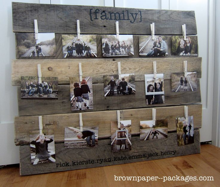 Wood Pallet Photo Display. Love the clothespins & the family names.