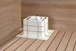 Integrated Nuoska is the focal point in a sauna. Nuoska is an electrical sauna heater.