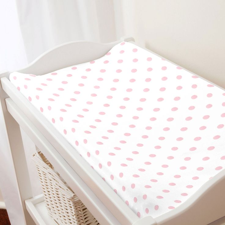 Changing Pad Cover in Pink Chevron and Dots by Carousel Designs.