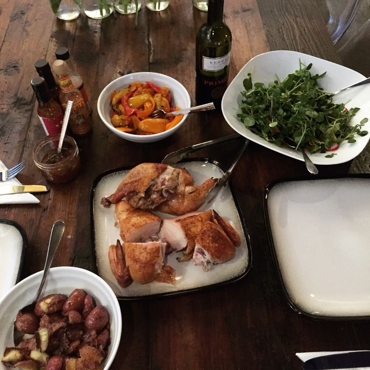 Dinner with friends after a weekend of indulgence is easy food like roasted organic chicken, smashed crispy potatoes, fried garlic, Chili sweet peppers and watercress salad.