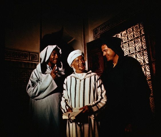 """Original caption:This is a scene from I Spy, a TV Series of 1965-1968, """"Oedipus at Colonus"""" filmed in Morocco with Robert Culp as Kelly Robinson, Maurice Evans as Jalibad, and Bill Cosby as Alexander Scott. The film was directed by Earl Bellamy and Richard Benedict."""