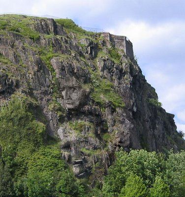Rock Faces Illusion  http://www.illusionspoint.com/hand-painted-optical-illusions/13-hidden-faces/