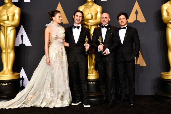 Hailee Steinfeld Photos Photos - (L-R) Actor Hailee Steinfeld, director Alan Barillaro and producer Marc Sondheimer, winners of Best Animated Short Film for 'Piper' and actor Gael Garcia Bernal pose in the press room during the 89th Annual Academy Awards at Hollywood & Highland Center on February 26, 2017 in Hollywood, California. - 89th Annual Academy Awards - Press Room