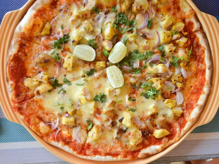 "Langkawi also cultivates its own island variation of Malay cooking, and the Kelapa Grill at the Four Seasons gives an example with the ""Kelapa Signature Pizza"" (pictured), with tomato sauce, mozzarella, onions, marinated chicken, lemongrass, ginger flower, chili, fresh lime, and coriander."