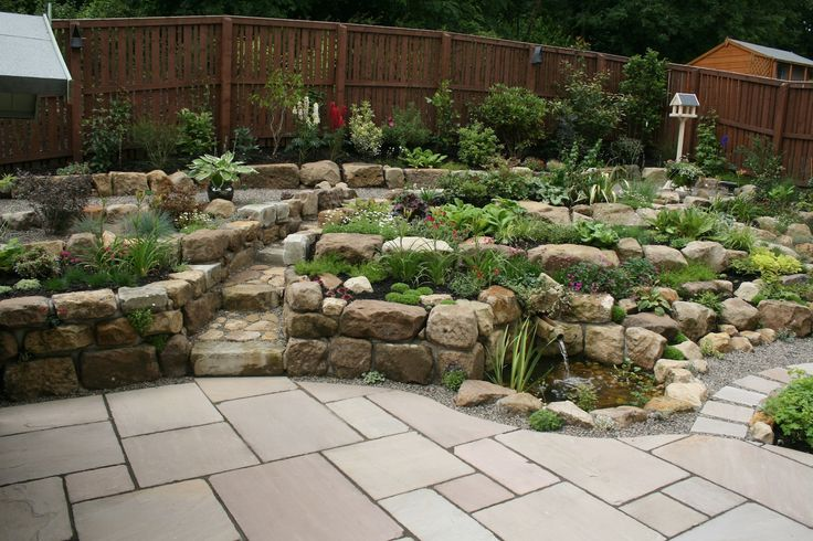 Rockery constructed using reclaimed natural sandstone with for Garden pond rockery ideas