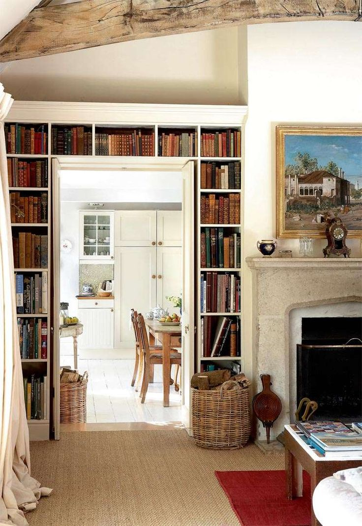 Living Room Library With Built In Bookcase And Tudor Arch Fireplace Surround