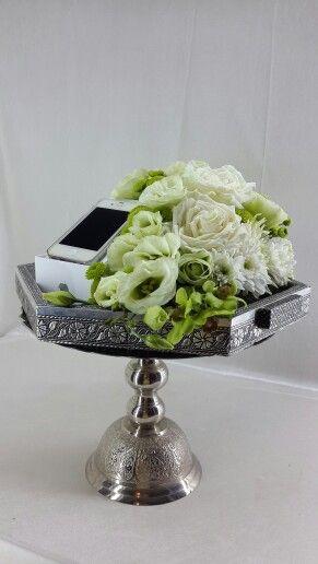 An iPhone as hantaran using fresh flower