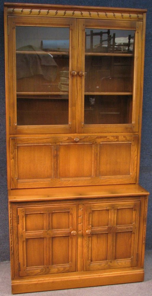 ercol elm mural glass top drinks cabinet on cupboard base wall unit rh pinterest com
