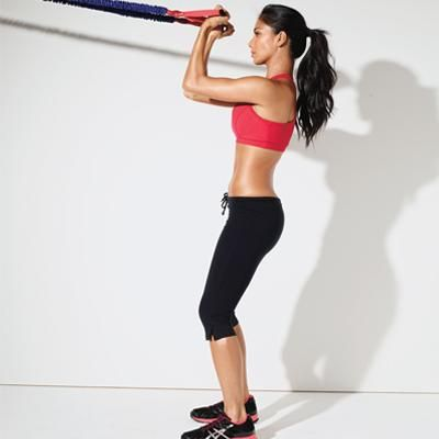 High curl:  Anchor a resistance tube around a high object (or in a doorjamb with the door closed) and stand facing it with feet hip-width apart, knees slightly bent. Hold a handle in each hand at shoulder height in front of you, palms facing up (tube should be taut). Bend elbows, curling hands toward head [shown], then extend arms to starting position. Do 12 to 15 reps.