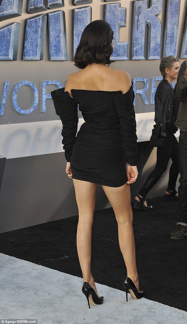 Cheeky: Her thigh-grazing mini dress hugged her perky posterior ...