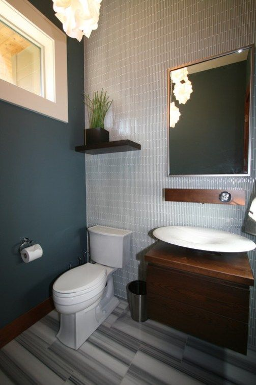 Best paint colour for a dark basement or room is Benjamin Moore Caribbean Teal, shown in small bathroom with tile floor and wall
