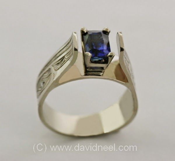 Raven Ring, white gold with a sapphire    #nativeamerican #firstnations #native =#haida #aboriginal #kwakiutl  http://www.davidneel.com/native-jewelry-diamond-rings-c-53_24.html