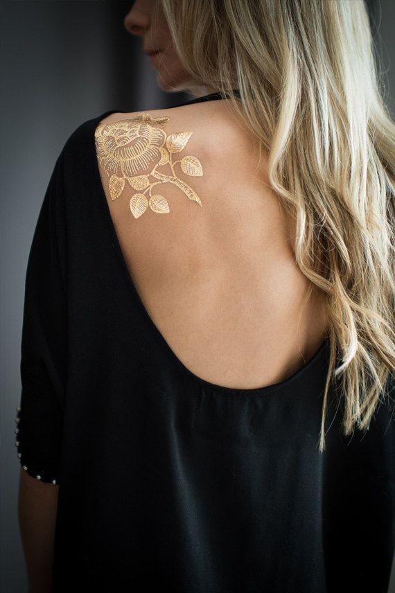 gold temp floral tattoo