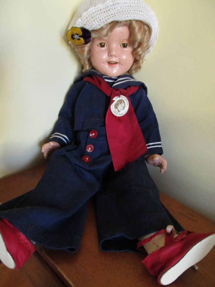 American Ideal Shirley Temple Doll wearing her Captain January out fit of 1936?