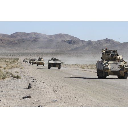 Convoy of military vehicles traveling in Fort Irwin California Canvas Art - Stocktrek Images (35 x 23)