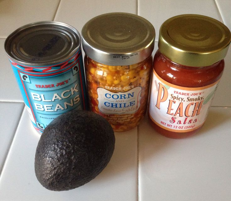 We make this and it's always a hit! Delicious!   Trader Joes Black Bean, Corn and Peach Salsa Dip! 1 can of black beans, 1 jar of Corn and Chile Tomato-Less Salsa, 1 jar of Spicy, Smoky Peach Salsa, 1 large avocado (diced). Mix ingredients together, chill and serve with tortilla chips.