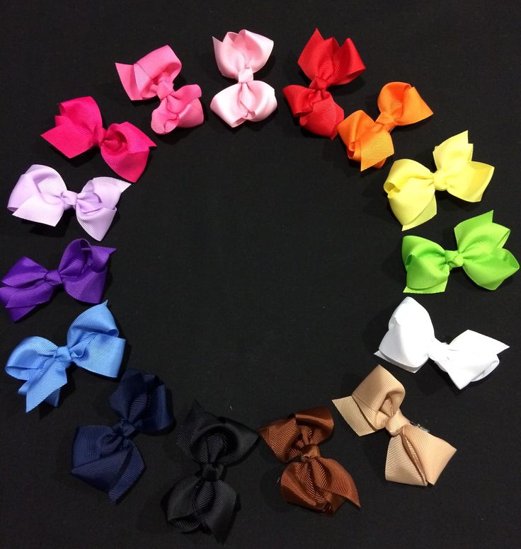 Small coloured bows on clips (or can be put on a headband) approx 2inch - sold in pairs :) but can be bought separately too