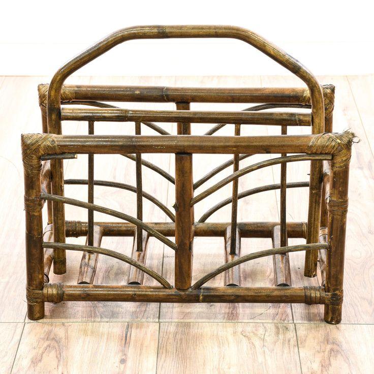 This tropical magazine rack is featured in a rattan wood with a glossy walnut stained finish. This bohemian magazine holder has a handle top, curved side details and 2 slots. Perfect for storing books or knitting supplies! #bohemian #storage #magazinerack #sandiegovintage #vintagefurniture