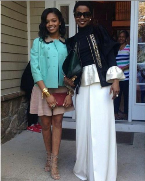Lauryn Hill and daughter Selah attend a wedding.