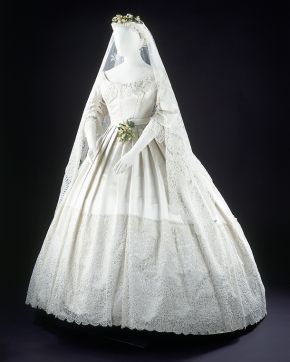 Wedding dress, England, 1865, worn at the wedding of Eliza Penelope Clay and Joseph Bright, St James's Church, Piccadilly, London, 16 February 1865, silk-satin dress trimmed with Honiton appliqué lace, machine-net and bobbin lace. Museum no. T.43-1947, © Victoria and Albert Museum, London