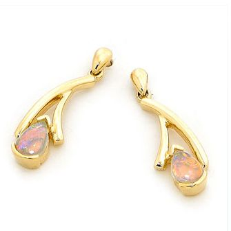 If you are looking for a unique design, this pair of drop earrings is the answer. Its specially contoured design add a touch of individuality to the piece. It is delicately crafted in half- bezel setting 18k yellow gold by our master craftsman, boasting with multi colour two pear-shaped solid light opal, sourced from quality opal mines in Coober Pedy, South Australia. A beautiful example of designer jewellery. #opalsaustralia