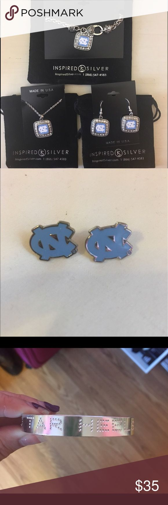 """Carolina Jewelry 5 Pieces!!! UNC Chapel Hill jewelry! You get everything in the pictures! This includes the inspired silver bracelet, earrings, and necklace, a bracelet that says """"Go Tar Heels"""", and NC stud earrings bought from the bookstore at UNC. The inspired silver set has never been worn! Jewelry"""