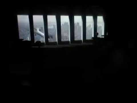 the world trade centre security camera footage  of the plane flying directly into the building ...