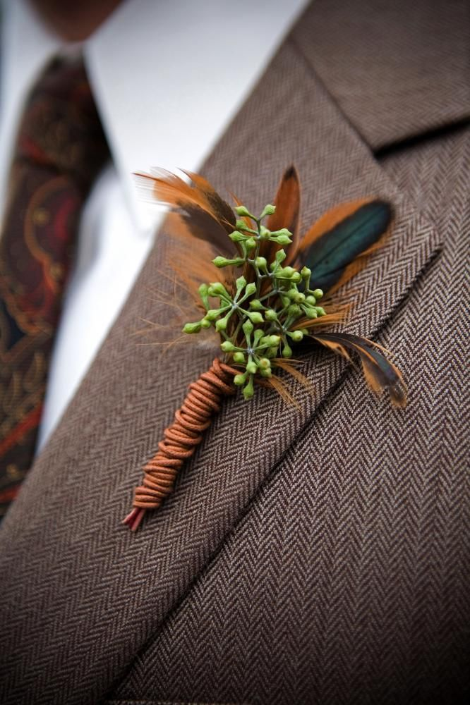 Seeded Eucalyptus backed with feathers results in a boutonniere that is sophisticated and masculine. Love it!