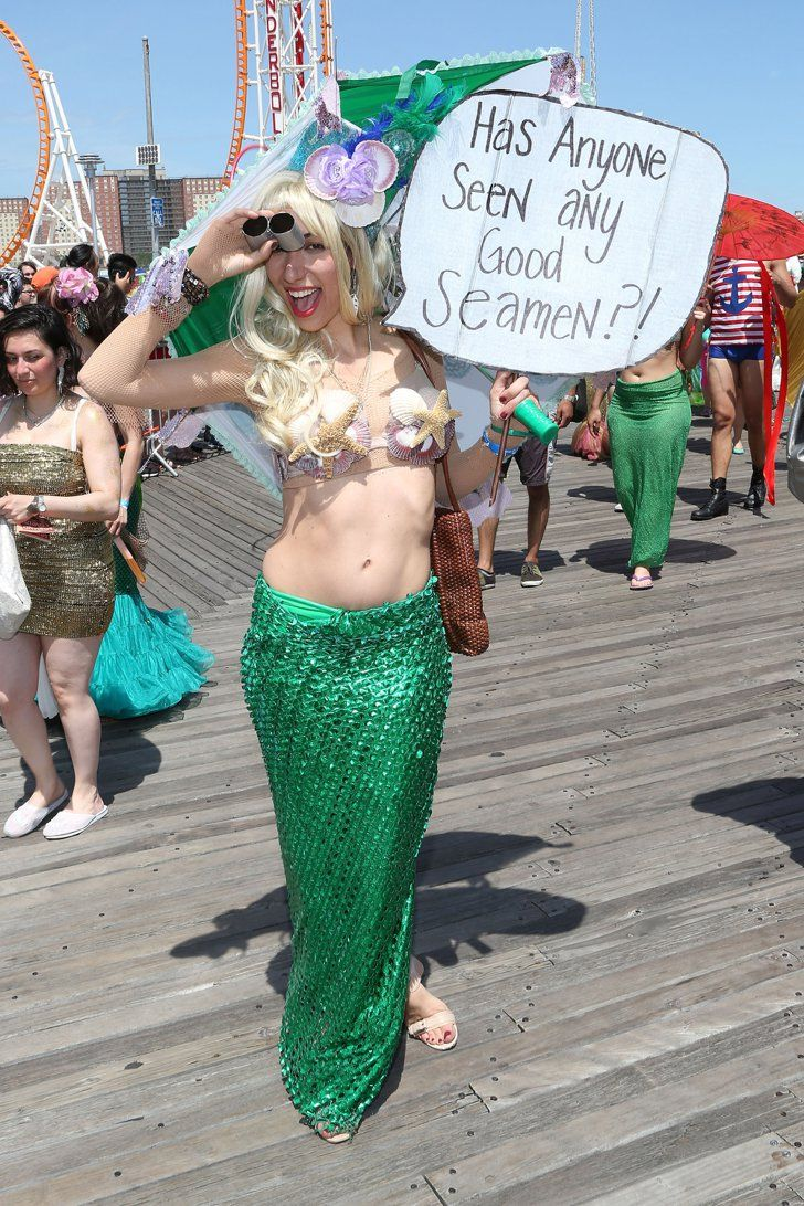Pin for Later: A History of Mermaids in Pop Culture Modern Mermaid Parade Not much has changed with the annual Coney Island mermaid parade. This lady posed in her scant attire at this year's event.