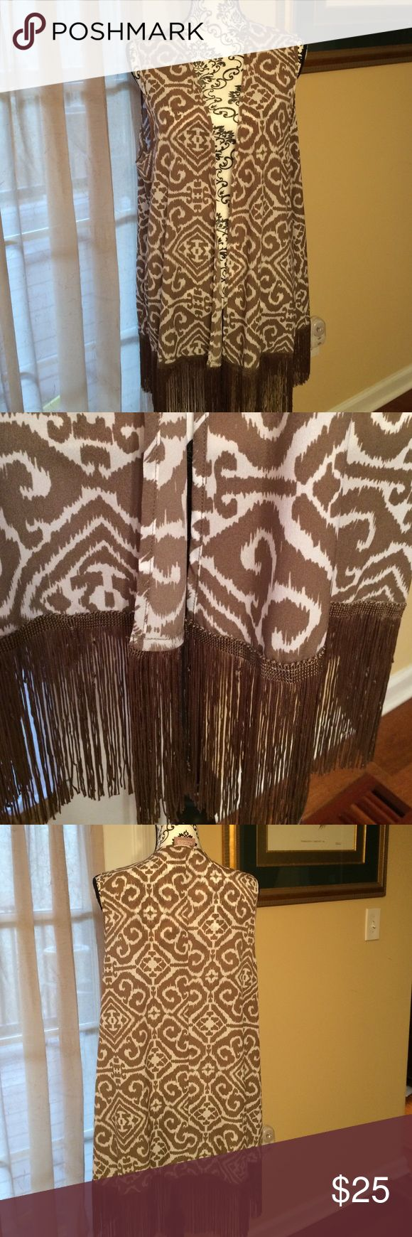 Chico's size 2 poly Duster with fringe Chico's size 2 poly Duster with fringe on bottom. Pretty pattern. New Chico's Jackets & Coats
