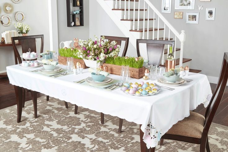 Place colored eggs atop wheatgrass flats in wooden boxes to give your table a bucolic vibe. Counterbalance the earthiness with delicate, whimsical elements like floral napkin rings, pastel-colored placemats, and dinnerware with an intricate beaded motif.   - CountryLiving.com