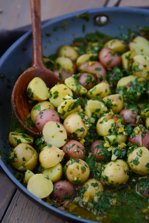 Simple boiled potatoes get dressed up with finely chopped chard in a garlicky lemon broth. Low on calories but full of flavor!