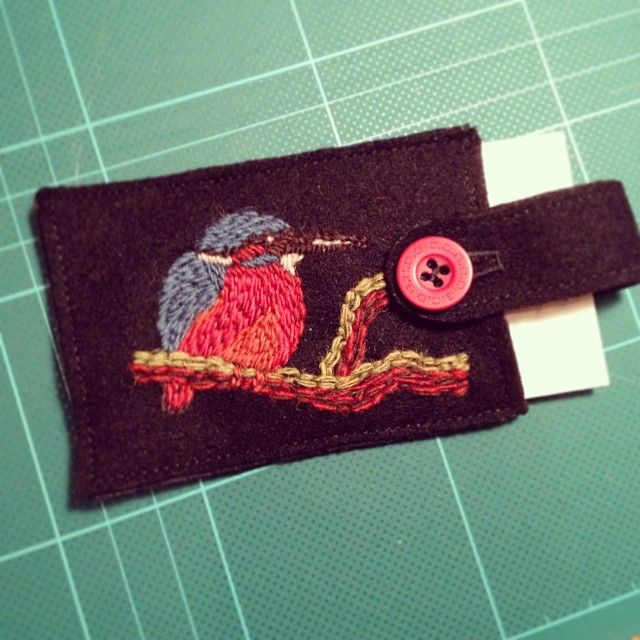 Bag tag in wool embroidery by Elna Carr